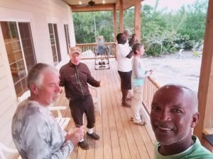 Benry Smith and his clients relax after a day of flat fishing and talk about who caught what. Red Bay Lodge - Andros Island Bahamas.